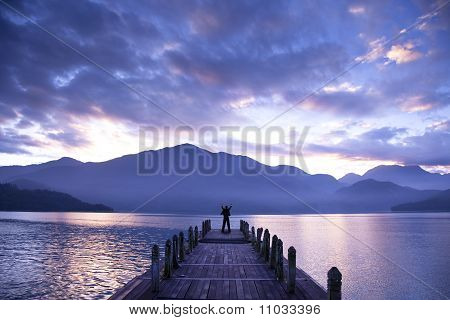 Man stand on a pier