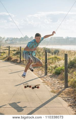 Teenager Jumping With Skateboard