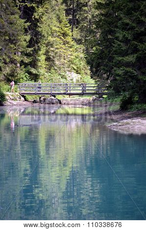 A wooden bridge over the braies Lake