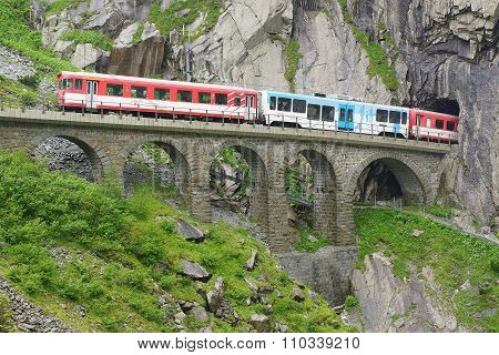 Devil's bridge with train at St. Gotthard pass.