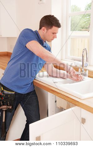 Plumber Fixing Tap With Adjustable Wrench