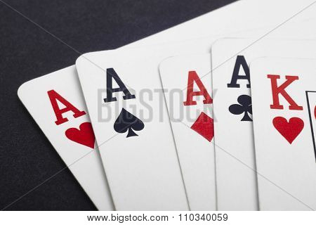 Poker Card Game With Four Aces And King. Black Background