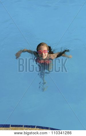 Young Girl Swimming Looking Up