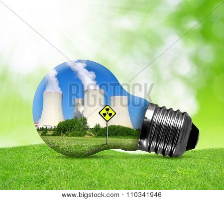 Nuclear power plant in bulb. Concept of nuclear energy.