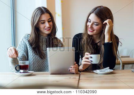 Beautiful Young Women Using Digital Tablet In Coffee Shop.