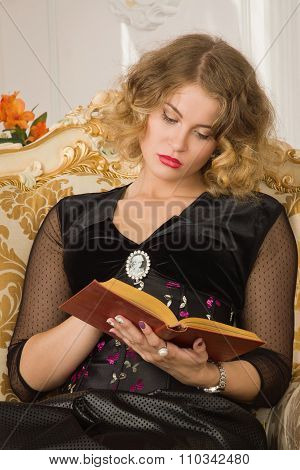 Pretty Woman Reading Book In A Boudoir