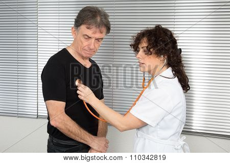 Doctor Checking Breathing With Stethoscop Of A Male Patient