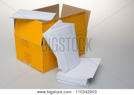 Photo Of Packaging With Envelopes Items Isolated On A White Background.