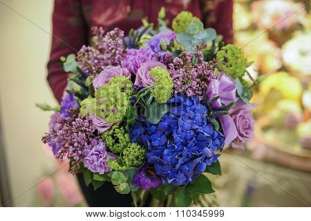 Bouquey Of Gree, Purple And Blue Flowers