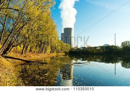 Nuclear Power Plant Next The Pond And Its Reflection