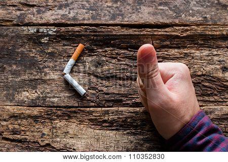 Man Shows Approval Of A Broken Cigarette Smoking Cessation