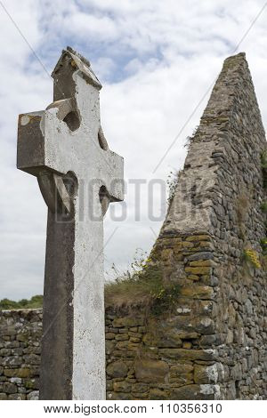 Celtic Cross And Church Ruins