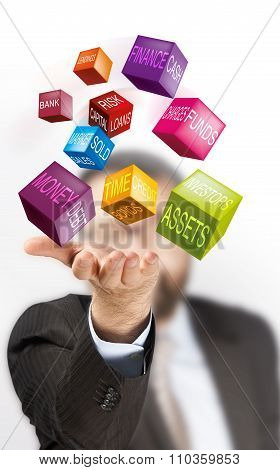 businessman with colored cubes finance concept