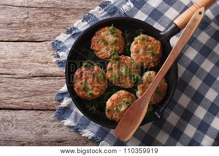 Fish Cakes With Herbs In A Frying Pan. Horizontal Top View