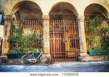 Old Bicycle Parked By A Beautiful Loggia In Florence