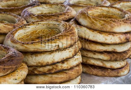 Kirghiz Bread Tokoch On Sunday Market In Osh. Kyrgyzstan.