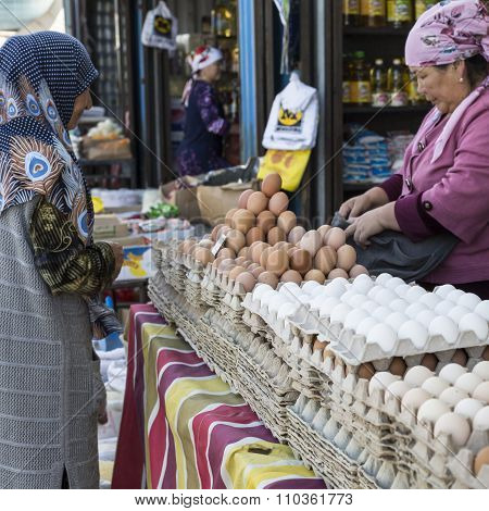 Bishkek, Kyrgyzstan - September 27, 2015 : Woman Selling Eggs In Local Market.