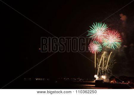 Colorful Fireworks Over Alghero Shoreline