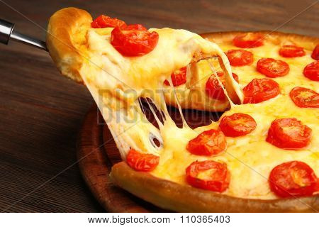 Pizza Margherita and removed slice on table