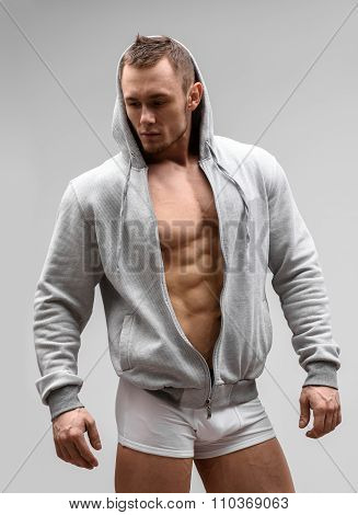 Athletic Man Fitness Model Posing In Underwear and hoodie