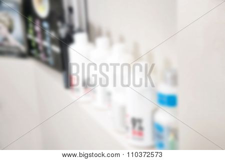 Out of focus background in white and beige tone. Hair dyeing accessories.