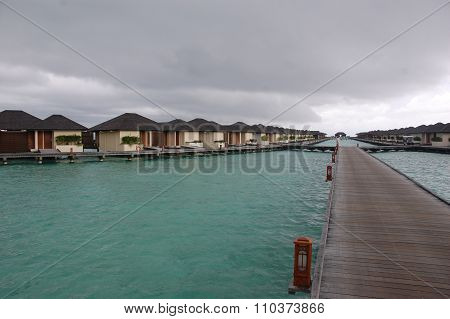 Timber Pier And Bungalow At Paradise Island Resort Maldives