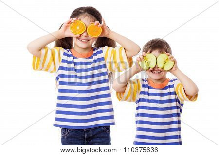 Two funny kids with fruits on face