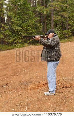Hunter aiming with an over/under shotgun