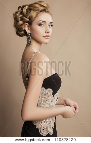 Woman With Blond Curly Hair And Evening Makeup,wears Luxurious Party Dress
