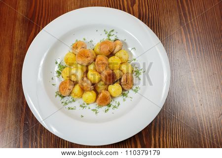 Fried, delicious potatoes on a plate. Potato with a hen.