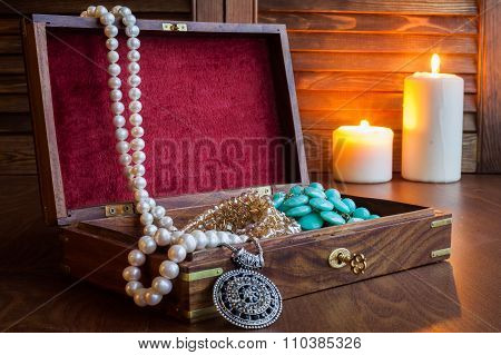 Jewelry Box And Jewelry On A Wooden Background