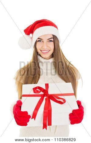 Santa girl holding a big Christmas gift box