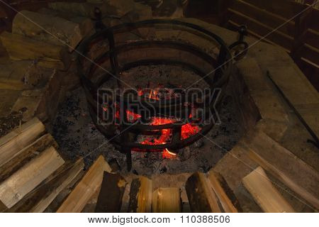 Fire In A Round Hearth And Wood