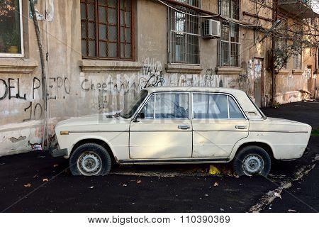 Road around an old car has been resurfaced in Baku, capital of Azerbaijan