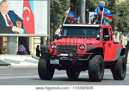 Tour d'Azerbaijan lead car with photo of Heydar Aliyev