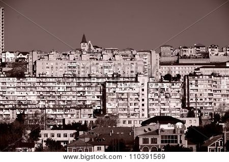 A skyline view of outer Baku, Azerbaijan, in black and white