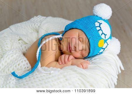 Sleeping smiling newborn baby