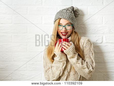 Smiling Hipster Girl in Winter Clothes with Mug