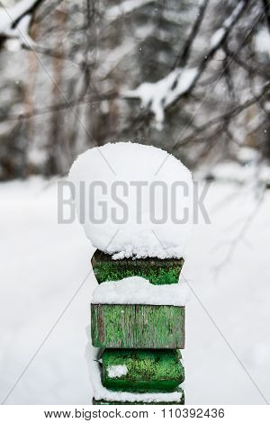 Snow Hat On The Fence In Winter Forest In Russia, Siberia