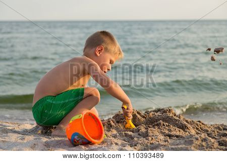 A boy playing on the beach.