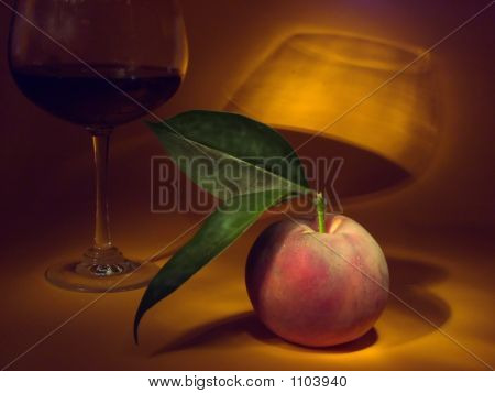 Still Life With Peach And Glass Of Wine