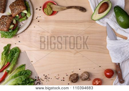 Burgers with shiitake on a wooden table with ingredients, top view, copy space.