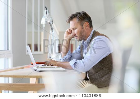 Man working on laptop computer