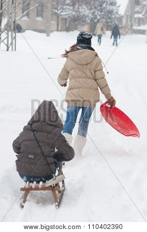 Teenage Girls Having Fun In The Deep Snow During Winter Blizzard