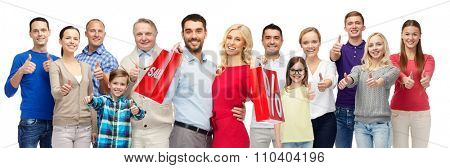 gesture, sale, shopping and people concept - group of smiling men, women and kids showing thumbs up