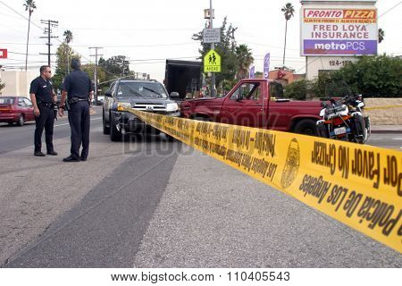 LONG BEACH, CALIFORNIA- DECEMBER 3, 2015: A High Speed Police Chase ends as the suspect car collides at an intersection with another car. Long Beach, California Dec. 3 2015