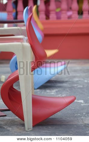Row Of Colourful Plastic Chairs