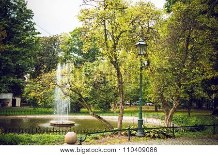 Beautiful European park with a fountain