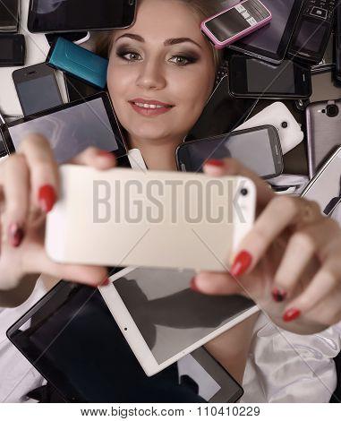 Digital technology as fetish. Girl doing selfie
