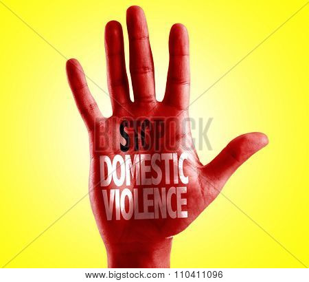 Stop Domestic Violence written on hand with yellow background